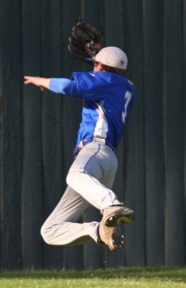 Tyler Green makes a lunging catch in front of the center field wall. (Photo by Rick Nation)
