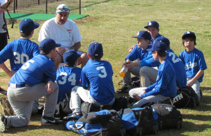 Dodgers coach Michael Catton meets with his team after Saturday's win. (Photo courtesy of Lara James)