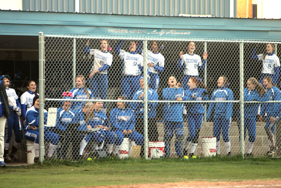 The Lady Hornets dugout cheers on their teammates. (Photo by Rick Nation)