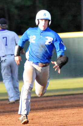 Trevor Ezell sprints towards third on his sixth-hitting triple. (PHoto by Kevin Nagle)