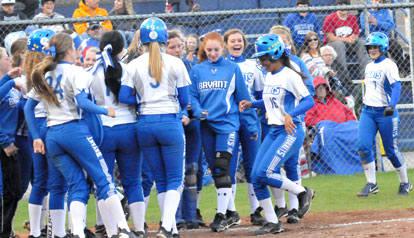 Brianna Forsyth is welcomed to the plate by her teammates after slugging a two-run home. (PHoto by Kevin Nagle)
