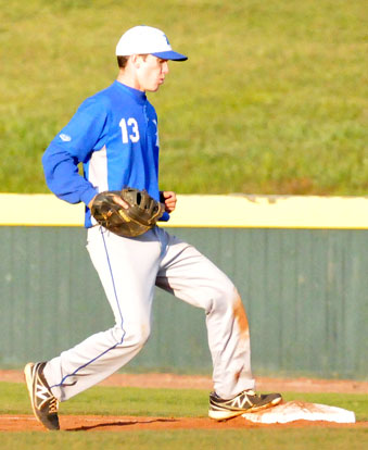 Ty Harris steps on first for the final out of Friday's game. (Photo by Kevin Nagle)