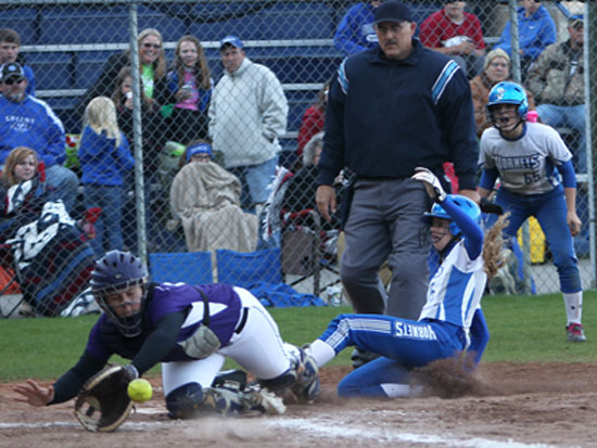 Sierra Jones slides safely home. (Photo by Rick Nation)