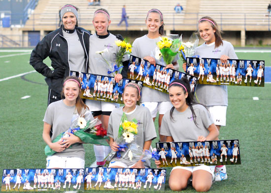 Head coach Julie Long, back left, with seniors, front from left, Morgan Hawkins, Shelby Gartrell, Lexie Balisterri; back row, Kaitlin Gaiser, Bailey Gartrell and Katie Barrington. (Photo by Kevin Nagle)
