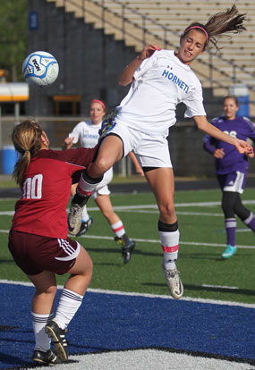 Bryant's Shelby Gartrell leaps to get a shot past the El Dorado keeper. (Photo by Rick Nation)