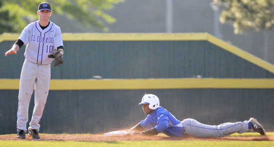 Marcus Wilson slides into third with a stolen base as El Dorado third baseman Matthew Lansdell awaits a throw that never came. (Photo by Kevin Nagle)