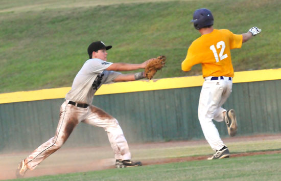 Bryant first baseman Bailey Bowers applies a tag on Ashdown's Drew Akins in the third inning of Wednesday's game. (Photo by Kevin Nagle)