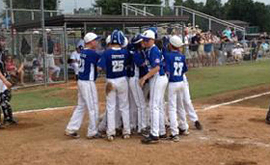 The Bryant 12-year-old All-Stars greet Cade Dupree after he belted a home run in Sunday's Regional Tournament game. (Photo by Madison McEntire)