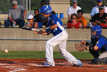 Coby Greiner gets a bunt down.