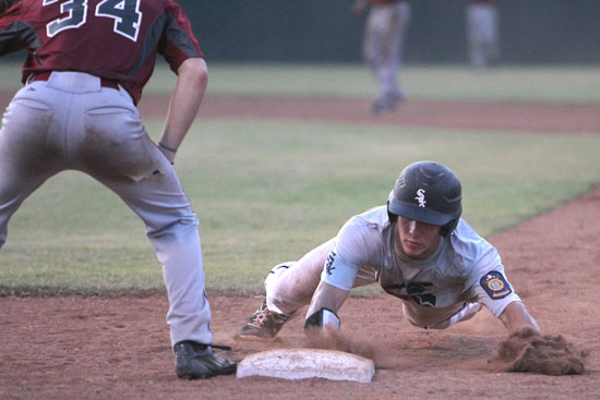Brandan Warner dives back into first on a pickoff attempt. (Photo by Rick Nation)
