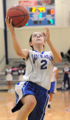 Kelly Williams drives in for a layup after making a steal during the second quarter of Monday's game. (Photo by Kevin Nagle)