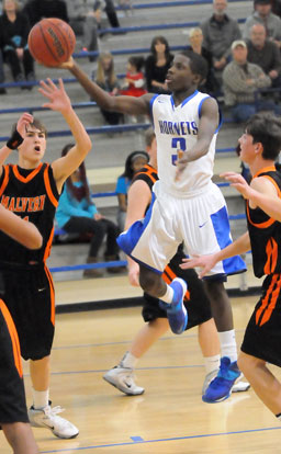 Calvin Allen (3) finishes off a drive with a finger-roll for 2 of his 7 points in Monday's game. (PHoto by Kevin Nagle)