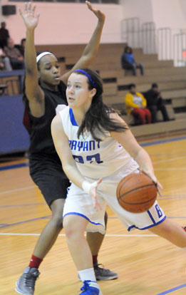 Rachel Barber tries to drive around a Pine Bluff defender. (Photo by Kevin Nagle)