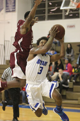C.J. Rainey (3) flashes past a Pine Bluff defender on a drive to the basket. (Photo by Rick Nation)