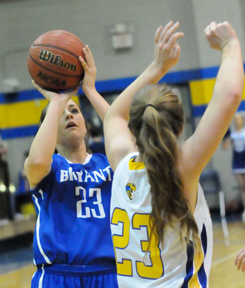 Bryant's 23, Aubree Allen, shoots over Sheridan's 23, Ashton Hill. (Photo by Kevin Nagle)