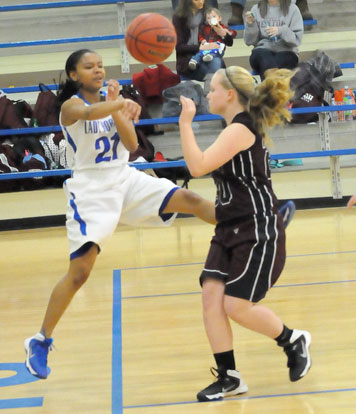 Destiny Martin (21) saves a ball from going out of bounds. (Photo by Kevin Nagle)