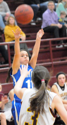 Macey Jaramillo puts up a 3-point try. (photo by Kevin Nagle)