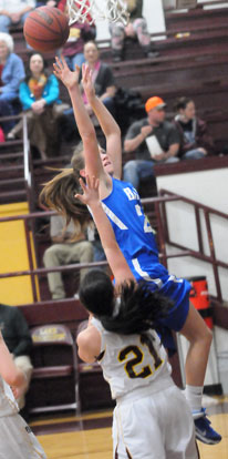 Kendal Rogers goes up for a shot off a drive to the hoop. (Photo by Kevin Nagle)