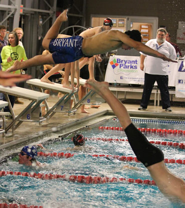 Fonzee Bittle dives in to start his leg of a relay. (Photo courtesy of Jamie Hester)