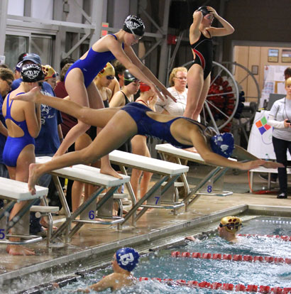 Reagan Smith starts her leg of a relay. (Photo courtesy of Jamie Hester)
