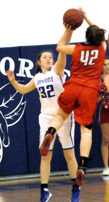 Annie Patton (32) defends against a shot by Cabot's Anna Sullivan. (Photo by Kevin Nagle)