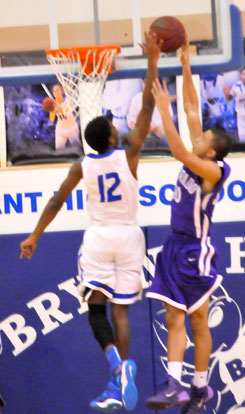Cedarrian Crosby (12) goes high to block a shot. (Photo by Kevin Nagle)