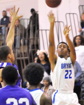 Romen Martin fires up a 3-pointer. (Photo by Kevin Nagle)