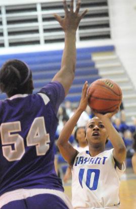 Jakeria Otey looks for room to shoot over El Dorado's 6-3 Taylor McCool. (Photo by Kevin Nagle)