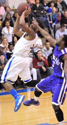 C.J. Rainey (3) reaches back to take a shot. (Photo by Kevin Nagle)