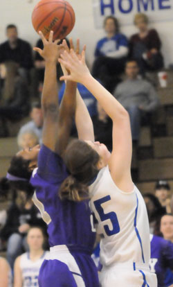 Bryant's Erica Smith (25) battles for a rebound. (Photo by Kevin Nagle)