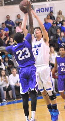 Bryant's Caleb Strain (5) tries to get a shot over El Dorado's Jalen Cunningham. (Photo by Kevin Nagle)