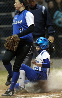 Bre Sanders slides in safely. (Photo by Rick Nation)