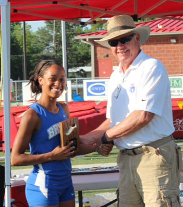 Melinda Murdock receives her fifth-place plaque at the 2014 Heptathlon.