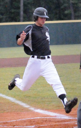Chase Tucker reaches home plate. (Photo by Kevin Nagle)