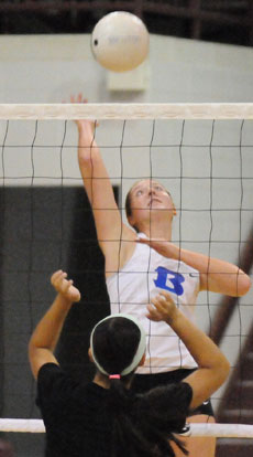Britney Sahlmann goes up for a hit during a team camp match at Benton recently. (Photo by Kevin Nagle)