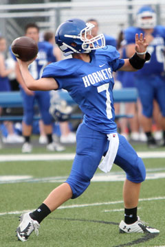 Myers Buck launches a pass. (Photo by Rick Nation)