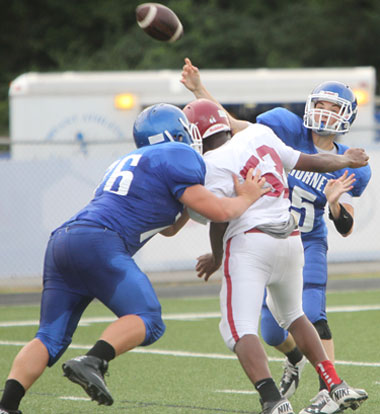 Cameron Vail tosses a pass as teammate Kobi Riffe (76) blocks Pine Bluff's Duncan Bailey. (Photo by Rick Nation)