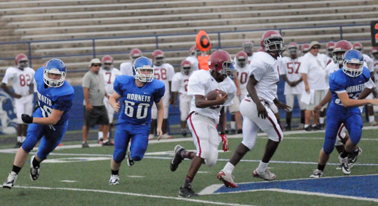 The Hornets, including Trace Talley (60) pursue a Pine Bluff Robey running back. (Photo by Kevin Nagle)