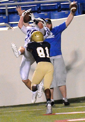 Paul Tierney hauls in a touchdown pass over a Pulaski Academy defender. (Photo by Kevin Nagle)