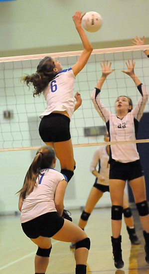 Allie Anderson goes high to spike the ball. (Photo by Kevin Nagle)