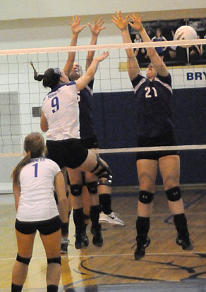Kendall Selig (9) follows through on a hit over a pair of Mount St. Mary defenders as Madison Greeno gets position to play a block. (Photo by Kevin Nagle)