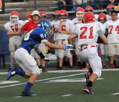 The Hornets' Logan Grant (88) bears down on Cabot North running back Mason Martin. (Photo by Kevin Nagle)