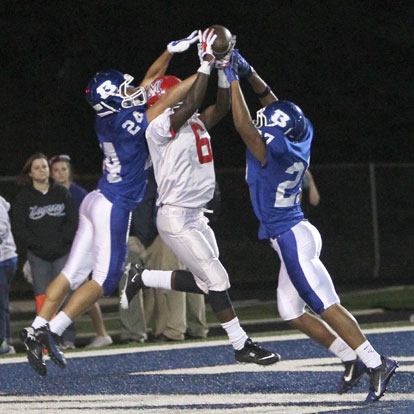 Nick Hardin (24) and Steven Murdock (27) prevent a touchdown catch by McClellan's Kenneth Buffington. (Photo by Rick Nation)