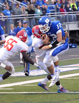 Brandan Warner (12) tries to fight through a tackle. (Photo by Kevin Nagle)