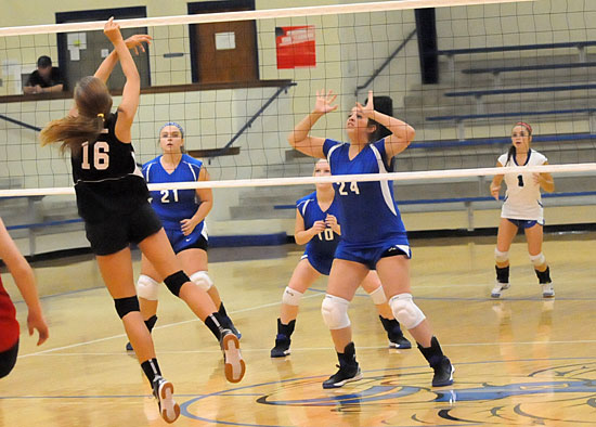 Ellen Barnes (24), Ally Benoit (21), Madi Draper (10) and Sidney Bosswell (1) prepare to receive a Cabot South hit. (Photo by Kevin Nagle)