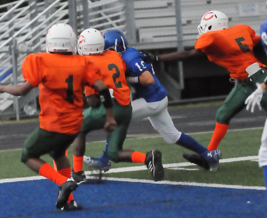 Quarterback Jesse Windemaker dashes across the goal line just inside the pylon as three Cloverdale defenders pursue. (Photo by Kevin Nagle)