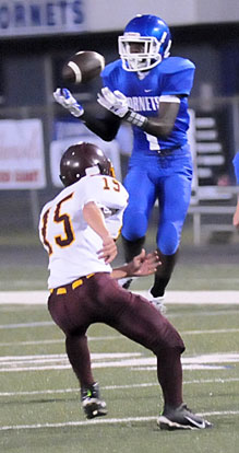 Jakalon Pittman leaps up for a pass reception he turned into a touchdown. (PHoto by Kevin Nagle)