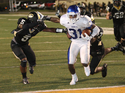Sevante Turner stiff-arms a Central defender on his way into the end zone. (PHoto by Rick Nation)