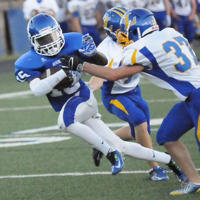 Chace Henson (15) tries to evade a Lakeside tackler. (Photo by Kevin Nagle)