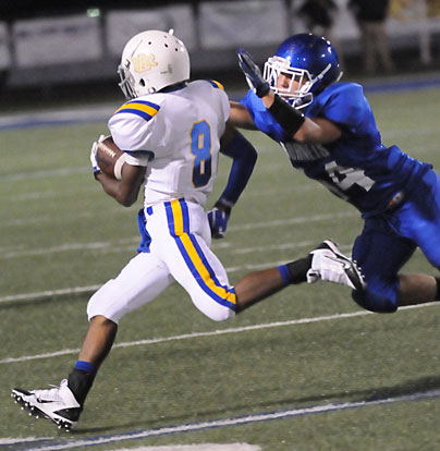 Parker Littleton (44) tracks down North Little Rock's Deontrae Montgomery (8). (Photo by Kevin Nagle)